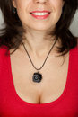 Woman with mini photocamera wearing a necklace a Royalty Free Stock Photo