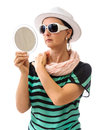Woman with mirror isolated on white hat and sunglasses arranging scarf in hand accessories sunglasses and hat Stock Photography