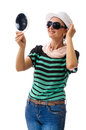 Woman with mirror isolated on white hat and sunglasses checking herself in accessories sunglasses and hat smiling Royalty Free Stock Images