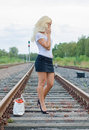 Woman missed the train calling someone on phone Royalty Free Stock Photography