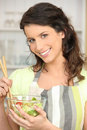 Woman mixing bowl of salad leaves Royalty Free Stock Photography
