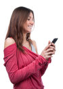 Woman with mobile cell phone mobile texting on touch screen young and smiling a white background Royalty Free Stock Image