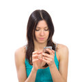 Woman with mobile cellphone finger touch the screen young online banking using her modern on a white background Stock Images