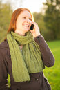 Woman with mobile phone in nature happy young talking on a and smiling Royalty Free Stock Photos
