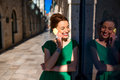 Woman with mobile phone in old city street young beautiful green dress using standing near the windoow on the dubrovnik croatia Royalty Free Stock Photos