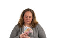 Woman with money in her hand has which she has earned or won and she looks at it Stock Image