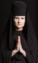 Woman in a monk robe. Royalty Free Stock Photo