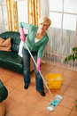 Woman mopping the floor in her home Royalty Free Stock Photography