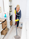 Woman mopping living room floor Royalty Free Stock Photos
