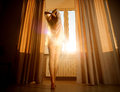 Woman in the morning. Attractive sexy woman with slender body is Royalty Free Stock Photo