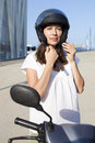 Woman with motor bike attractive helmet Stock Image