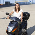 Woman with motor bike attractive smiling Stock Image