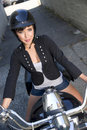 Woman motorcycle rider Stock Images