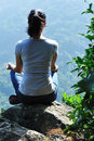 Woman mountain top yoga  Stock Photos
