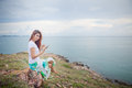 Woman on mountain young asian use tablet pc and sea Royalty Free Stock Images