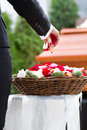 Woman mourning on funeral with coffin flowers standing at casket or Royalty Free Stock Image