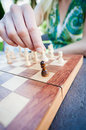 Woman moves piece in chess close up of female hand Royalty Free Stock Images