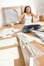 Woman moving in - furniture assembly frustration Royalty Free Stock Image