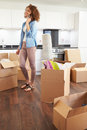Woman moving into new home talking on mobile phone her own Royalty Free Stock Images