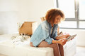 Woman Moving Into New Home Using Digital Tablet Royalty Free Stock Photo