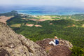 Woman on mt nosoko ishigaki a sits and admires the coastal view from the top of mount in okinawa japan Royalty Free Stock Image