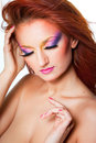 Woman with multicolored make-up Stock Photos