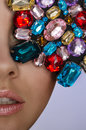 Woman with multicolored stones portrait of beautiful Royalty Free Stock Photos