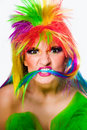 Woman with multicolored wig looking aggressively Royalty Free Stock Image