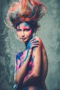 Woman muse with body art young creative and hairdo Royalty Free Stock Photography