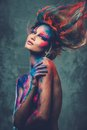 Woman muse with body art young creative and hairdo Royalty Free Stock Image