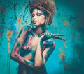 Woman muse with body art young creative and hairdo holding paint brushes Royalty Free Stock Photography
