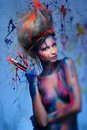 Woman muse with body art young creative and hairdo holding paint brushes Royalty Free Stock Photos