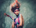 Woman muse with body art young creative and hairdo holding paint brushes Stock Image