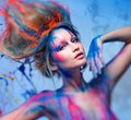 Woman muse with creative body art young and hairdo Stock Image