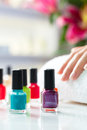 Woman in nail salon receiving manicure Stock Photography