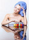 Woman with nail varnish young pretty spa in blue bath towel on head over mirror table on white background Stock Photo