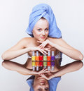 Woman with nail varnish young pretty spa in blue bath towel on head over mirror table on white background Stock Image