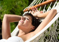 Woman napping in hammock on summer Stock Images