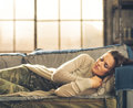 Woman napping on a sofa in a city loft Royalty Free Stock Photo