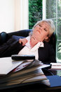 Woman naps at her desk Royalty Free Stock Photos
