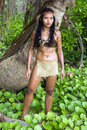 Woman in native costume stands in the tropical nature tribal jungle Royalty Free Stock Images