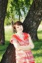 Woman near a birch tree  Stock Photography
