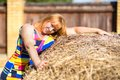 Woman near a haystack portrait of Stock Image