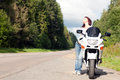 Woman near a motorcycle Royalty Free Stock Photo