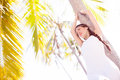 Woman near palm tree Stock Images