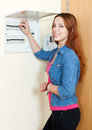 Woman near power control panel at home Stock Images