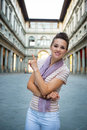 Woman near uffizi gallery pointing in florence Royalty Free Stock Photo