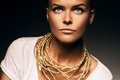 Woman with necklace of gold rope Royalty Free Stock Photo