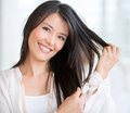 Woman in need of a haircut happy at the beauty salon Stock Images