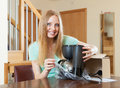 Woman with new coffee machine in home interior young Stock Photos